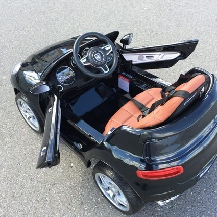 Электромобиль Porsche Macan черный (резиновые колеса, кожа, пульт, музыка, ГЛЯНЦЕВАЯ ПОКРАСКА)